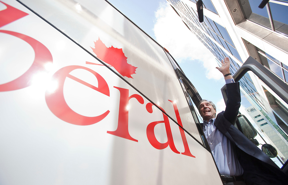 Liberal leader Michael Ignatieff waves to a crowd of supporters as he boards his campaign bus in Ottawa, Ontario, March 26, 2011 for a election campaign which will send Canadians to the polls May 2.<br /> AFP/GEOFF ROBINS/STR