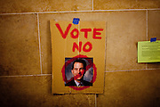 A sign against Wisconsin Gov. Scott Walker is taped to the wall of the State Capitol as protests continue over efforts to cut collective bargaining rights for unions for the tenth day in Madison, WI, February 24, 2011.