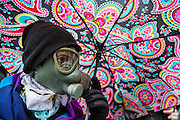 WASHINGTON, USA - January 20: An anti-Trump protestor in a gas mask with an umbrella faces off with police after President Trump was sworn into office in Washington, USA on January 20, 2017.