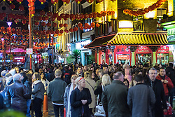 London, February 14th 2016. Londoners and tourists crowd Chinatown and the West End as the city's Chinese community celebrate Chinese New Year - The Year of the Monkey. ///FOR LICENCING CONTACT: paul@pauldaveycreative.co.uk TEL:+44 (0) 7966 016 296 or +44 (0) 20 8969 6875. ©2015 Paul R Davey. All rights reserved.