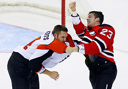 Oct 24, 2008; Newark, NJ, USA; New Jersey Devils right wing David Clarkson (23) and Philadelphia Flyers defenseman Andrew Alberts (41) fight during the second period at the Prudential Center.