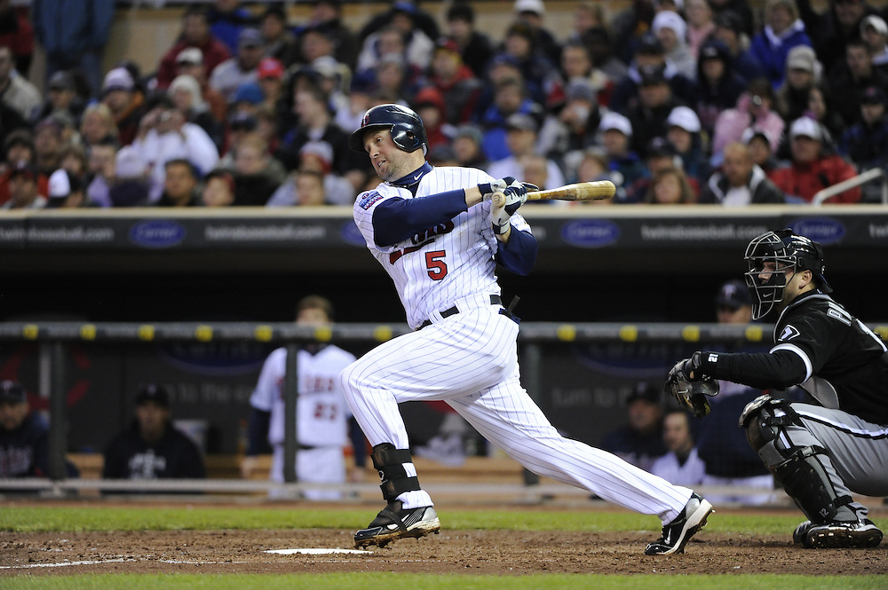 MINNEAPOLIS - MAY 11:  Michael Cuddyer #5 of the Minnesota Twins bats against the Chicago White Sox on May 11, 2010 at Target Field in Minneapolis, Minnesota.  The White Sox defeated the Twins 5-2.  (Photo by Ron Vesely)