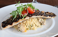 Grilled Branzino over couscous, clams and roasted lemon vinaigrette prepared by Executive Chef Ross Mendoza at Forty North in Hastings, NY on Friday, July 18, 2014.  © Chet Gordon / Westchester Magazine