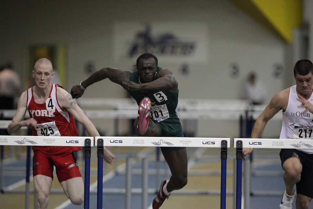 Windsor, Ontario ---13/03/09--- Valery Komenan of  Universite de Sherbrooke competes in the 60 meter hurdles at the CIS track and field championships in Windsor, Ontario, March 13, 2009..GEOFF ROBINS Mundo Sport Images