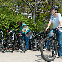 Students take advantage of the Tufts Bikes Program outside the Tisch Library at Tufts University.