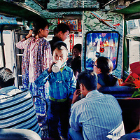 People in a local bus. Everywhere, people can be seen wearing the surgical masks fearing the outbreak of an epidemic.