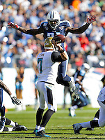 Tennessee Titans Bernard Pollard leaps to put pressure on the Jacksonville Jaguars quarterback Chad Henne during the game at LP Field in Nashville, TN on November 10, 2013. Photos by Donn Jones Photography.