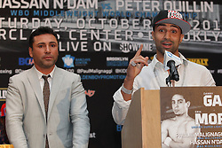 Aug 30, 2012; Brooklyn, NY, USA; WBA Welterweight Champion Paulie Malignaggi speaks at the press conference at New York Marriott at the Brooklyn Bridge as promoter Oscar DeLaHoya looks on. The press conference announced the upcoming October 20th card at the Barclay's Center.