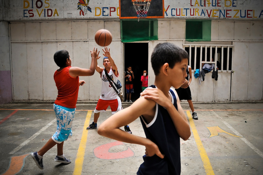 """Boys play basketball as part of a sports program organized by the """"Tower of David"""" community council to keep children living in the skyscraper out of trouble."""