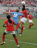 Ohio State defender Liz Sullivan (7) goes up against University of North Carolina midfielder Amber Brooks (22) as OSU takes on UNC in the first half of an NCAA women's college soccer game in Columbus, Ohio on Sunday, Sept. 4, 2011, at Jesse Owens Memorial Stadium.