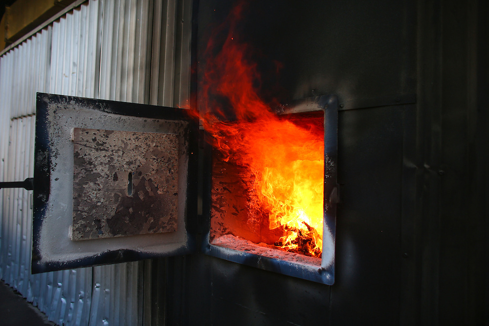 The fire in the dryer at Hacienda Alsacia is shown during the 2016 Starbucks Origin Experience for Partners. Photographed in January 2016. (Joshua Trujillo, Starbucks)