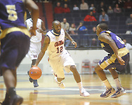 "Ole Miss guard Chris Warren (12) dribbles vs. Alcorn State at the C.M. ""Tad"" Smith Coliseum in Oxford, Miss. on Thursday, December 29, 2010. (AP Photo/Oxford Eagle, Bruce Newman)"