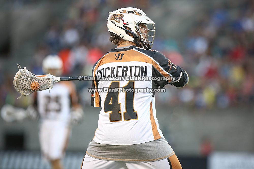 Mark Cockerton #41 of the Rochester Rattlers prepares to throw the ball during the game at Harvard Stadium on August 9, 2014 in Boston, Massachusetts. (Photo by Elan Kawesch)