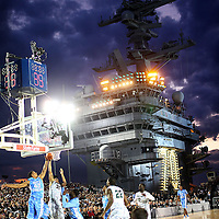 University of North Carolina  battles Michigan State aboard the Aircraft Carrier USS Vinson during the Carrier Classic on Veterans Day in Coronado, CA.  This was the first NCAA Basketball game ever held aboard a Navy Carrier and was attended by U.S. President Barack Obama and First Lady Michelle Obama.