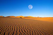 Full moon over dune patterns, Mesquite Flat Sand Dunes, Death Valley National Park, California