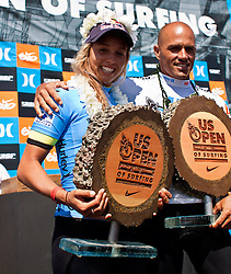 HUNTINGTON BEACH, California/USA (Sunday,Aug 7, 2011) 10-Time ASP World Champion Kelly Slater (Cocoa Beach, FL), 39, embraces Sally Fitzgibbons (AUS), 20,  at the awards ceremonies platform late afternoon  at  the U.S. Open of Surfing 2011. Fitzgibbons won the Women's Nike US Open of Surfing 2011. Photo: Eduardo E. Silva.