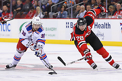 Oct 21, 2014; Newark, NJ, USA; New York Rangers right wing Mats Zuccarello (36) plays the puck while being defended by New Jersey Devils left wing Patrik Elias (26) during the second period at Prudential Center.
