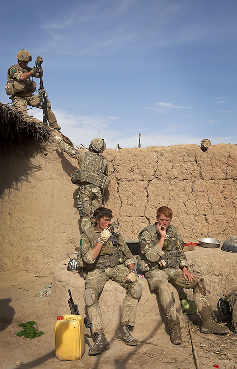 British soldiers of 3PARA search and then occupy a local compound to provide overwatch after an IED is discovered and diffused whilst on foot patrol in Nad Ali, Hemand Province, Afghanistan on the 11th of March 2011.