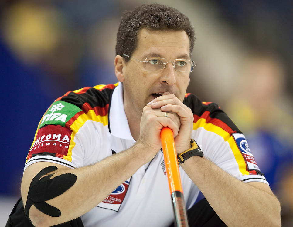 German skip Andy Kapp watches his shot during Germany's match against the Czech Republic at the World Curling Championships at the Brandt Centre in Regina, Saskatchewan, April 7, 2011.<br /> AFP PHOTO/Geoff Robins
