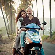 A tourist couple on a scooter in Goa
