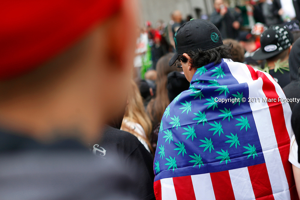 SHOT 4/20/11 4:48:21 PM - Marijuana enthusiasts converged upon Denver, Colorado and Civic Center Park for an event that has come to symbolize Colorado's burgeoning claim as the nation's cannabis capital. Denver's annual April 20th pro-marijuana smoke-out -- known as the 420 Rally -- is reputedly the largest of its kind in the world on a day that has come to be regarded as a ganja holiday. The crowd was estimated at about 10,000 participants and the signature moment of the rally occurred at 4:20 p.m., when participants collectively lit up and a thick cloud of marijuana smoke rose over the park within site of the state capital. Organizers say the goal of the rally is to bring people together to protest peacefully marijuana prohibition. Includes images of event organizer Miguel Lopez..(Photo by Marc Piscotty / © 2011)