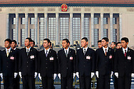 Chinese soldiers stand guard in front of the Great Hall of the People at Tiananmen square in Beijing, China, Thursday, March 5, 2009. China's National People's Congress is a largely powerless body but it represents one of the country's last displays of old style communism. Ethnic minority delegates from around the country attend the meetings wearing traditional costumes, a conceit which allows the government to argue that the nation's different cultures co-exist harmoniously. Little is decided at these gatherings though. The NPC functions largely as a rubber stamp body for policies put forward by the Communist party's elite.