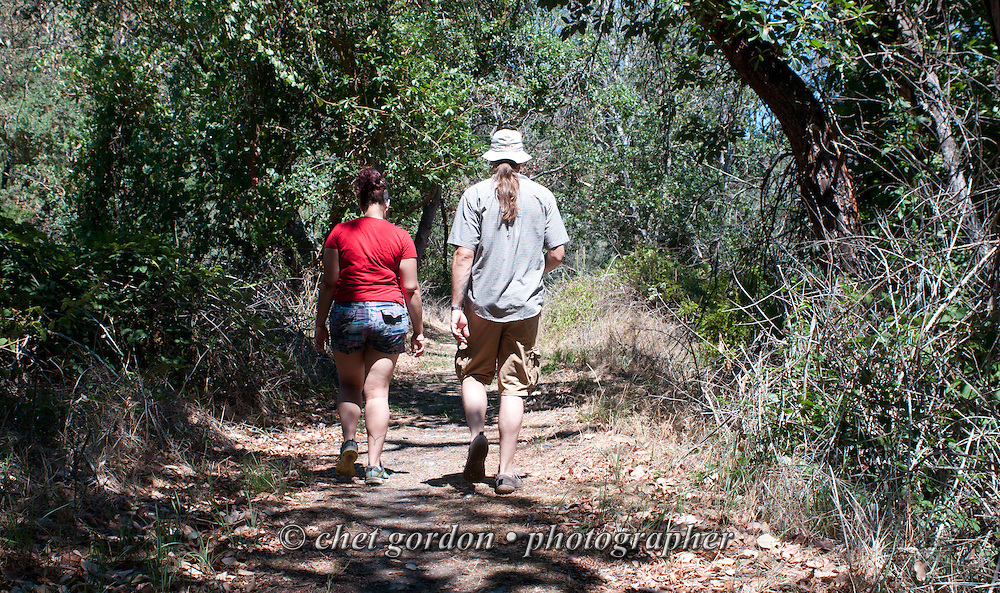 A couple walk along a trail near the Rogue River in Gold Hill, OR on Sunday, July 24, 2016.  © Chet Gordon • Photographer  #oregon #OR #goldhill #rogueriver #gold #photojournalism #travel