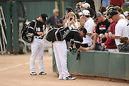 GLENDALE, AZ - MARCH 05:  Brent Morel and Brent Lillibridge of the Chicago White Sox sign autographs prior to the game against the Los Angeles Dodgers on March 5, 2012 at The Ballpark at Camelback Ranch in Glendale, Arizona. The Dodgers defeated the White Sox 6-4.  (Photo by Ron Vesely)  Subject:  Brent Morel, Brent Lillibridge