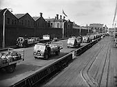 1958 - Guinness transport lorries on the wharf outside St James's Gate Brewery, Dublin