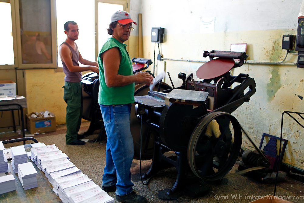 Central America, Cuba, Caibarien. Print Shop Press Operators printing meal tickets.