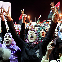 Thousands of Libyans demonstrate against the government in Tripoli and in favor of the no fly zone during a rally in Benghazi, Libya. March 2011.