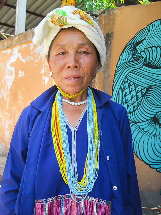 This woman is wearing a popular necklace and set of earrings for older women in Karen culture. This woman is shopping in the convenient shop in Mida's village.