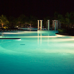 The pool in a fancy resort in the Mexican Riviera Maya after dark.