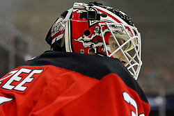 Mar 13, 2013; Newark, NJ, USA; New Jersey Devils goalie Jeff Frazee (31) during warmups for their game against the Philadelphia Flyers at the Prudential Center.