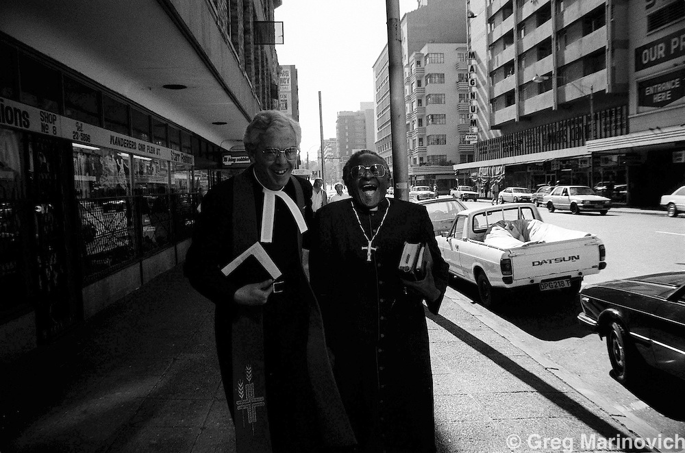 Anti apartheid campaigner Archbishop Desmond Tutu, rightm, laughs after delivering an anti-apartheid sermon in Johannesburg, 1985.  (Greg Marinovich)