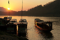 Mekong River Sunset - The Mekong River flows for over four thousand kilometers from the Tibetan Plateau through China then finally Indochina,