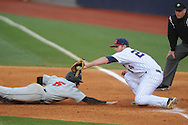 Ole Miss's Sikes Orvis (24) tags out Arkansas State's Alex Potts (6) on a pickoff at Oxford-University Stadium in Oxford, Miss. on Wednesday, March 27, 2013.