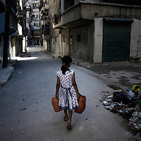 SYRIA, ALEPPO. A child carrying two small tank of water in Aleppo, on September 26, 2012. Many neighborhoods are experiencing a serious shortage of water. ALESSIO ROMENZI
