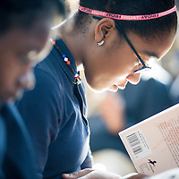 A student reading A Wrinkle In Time at the Epiphany School in Dorchester photographed for the school's Annual Report.