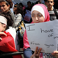 2 girls demonstrate outside the Syrian Embassy calling for a Free Syria