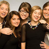 Group of teen girls pose for the camera.