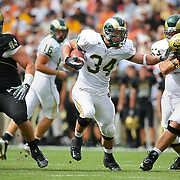 SHOT 9/1/2007 - Colorado State's Kyle Bell (#34, RB)runs through a hole created by his teammates while avoiding Colorado's Brandon Nicolas (#94, DT) and Alonzo Barrett (#47, DE) during the first half of the Rocky Mountain Showdown Saturday September 1, 2007 at Invesco Field in Denver, Co. The University of Colorado won the Centennial Cup with a 31-28 overtime victory in the game. Colorado and Colorado State have met 78 times in their histories, but the first 69 took place on their respective campuses. The Colorado Buffaloes are in the Big 12 Conference, while the Colorado State Rams compete in the Mountain West Conference. Bell rushed 40 times for 135 yards and a touchdown in the game..(Photo by Marc Piscotty © 2007)