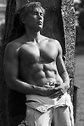 Asian American man with no shirt and open pants