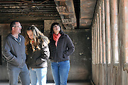 em020112m/jnorth/daily/From left, Terry New, with his daughters Emily New, 17, and Allison New, 16, from Moriarty, tour a burned out section of the New Mexico State Pentitentiary near Santa Fe, Wednesday Febuary 1, 2012. This section was burned durning the 1980 riot. Allison and Emily won a national award for their history project on the Duran Consent Decree. This was during a media tour at the prison. (Eddie Moore/Albuquerque Journal)