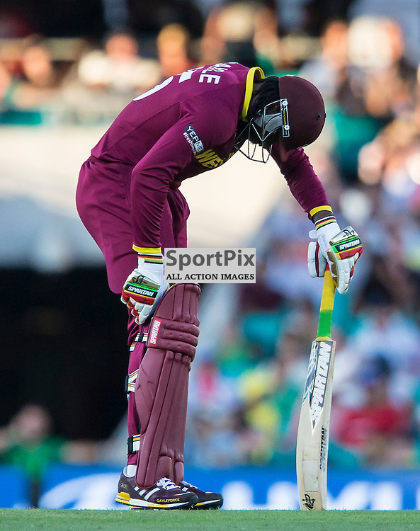 ICC Cricket World Cup 2015 Tournament Match, South Africa v West Indies, Sydney Cricket Ground; 27th February 2015<br /> West Indies Chris Gayle holds his knee after being hit