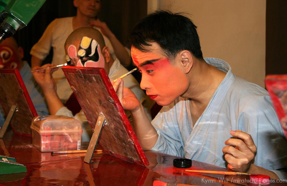 Asia, China, Beijing. Beijing Opera Performers backstage applying make-up.
