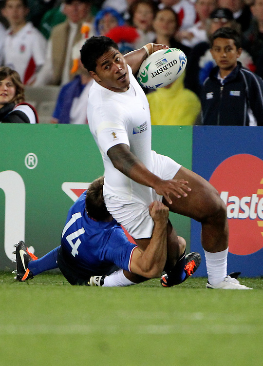 England's Manu Tuilagi is tackled by Frances Vincent Clerc in their Rugby World Cup quarter-final match at Eden Park, Auckland,  New Zealand, Saturday, October 08, 2011. Credit:SNPA / John Cowpland