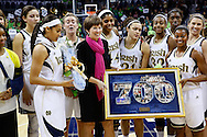 SOUTH BEND, IN - FEBRUARY 11: Head coach Muffet McGraw of the Notre Dame Fighting Irish is honored for her 700 wins after the game against the Louisville Cardinals at Purcel Pavilion on February 11, 2013 in South Bend, Indiana. Notre Dame defeated Louisville 93-64. (Photo by Michael Hickey/Getty Images) *** Local Caption *** Muffet McGraw