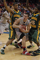 Ohio State guard Aaron Craft (4) calls a timeout in OSU's 98-66 win against George Mason in the third round of the NCAA Tournament on March 20, 2011, in Cleveland.