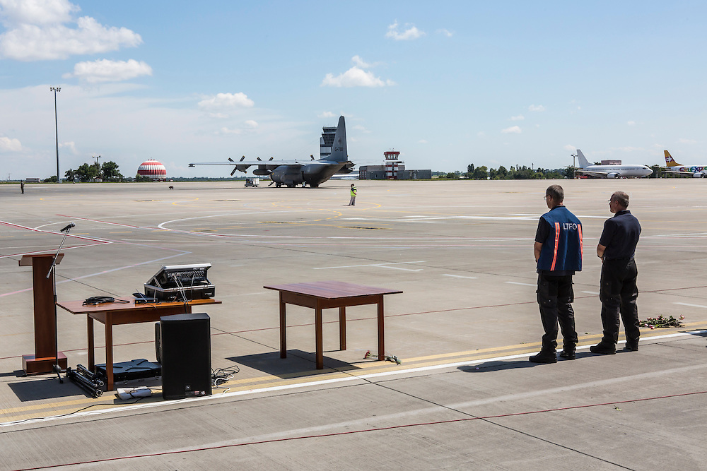 KHARKIV, UKRAINE - JULY 23: Peter van Vliet (2nd R), leader of the Dutch forensics team investigating the crash of Malaysia Airlines flight MH17, watches a plane containing the bodies of crash victims takes off to the Netherlands during a departure ceremony on July 23, 2014 in Kharkiv, Ukraine. Malaysia Airlines flight MH17 was travelling from Amsterdam to Kuala Lumpur when it crashed killing all 298 on board including 80 children. The aircraft was allegedly shot down by a missile and investigations continue over the perpetrators of the attack. (Photo by Brendan Hoffman/Getty Images) *** Local Caption *** Peter van Vliet